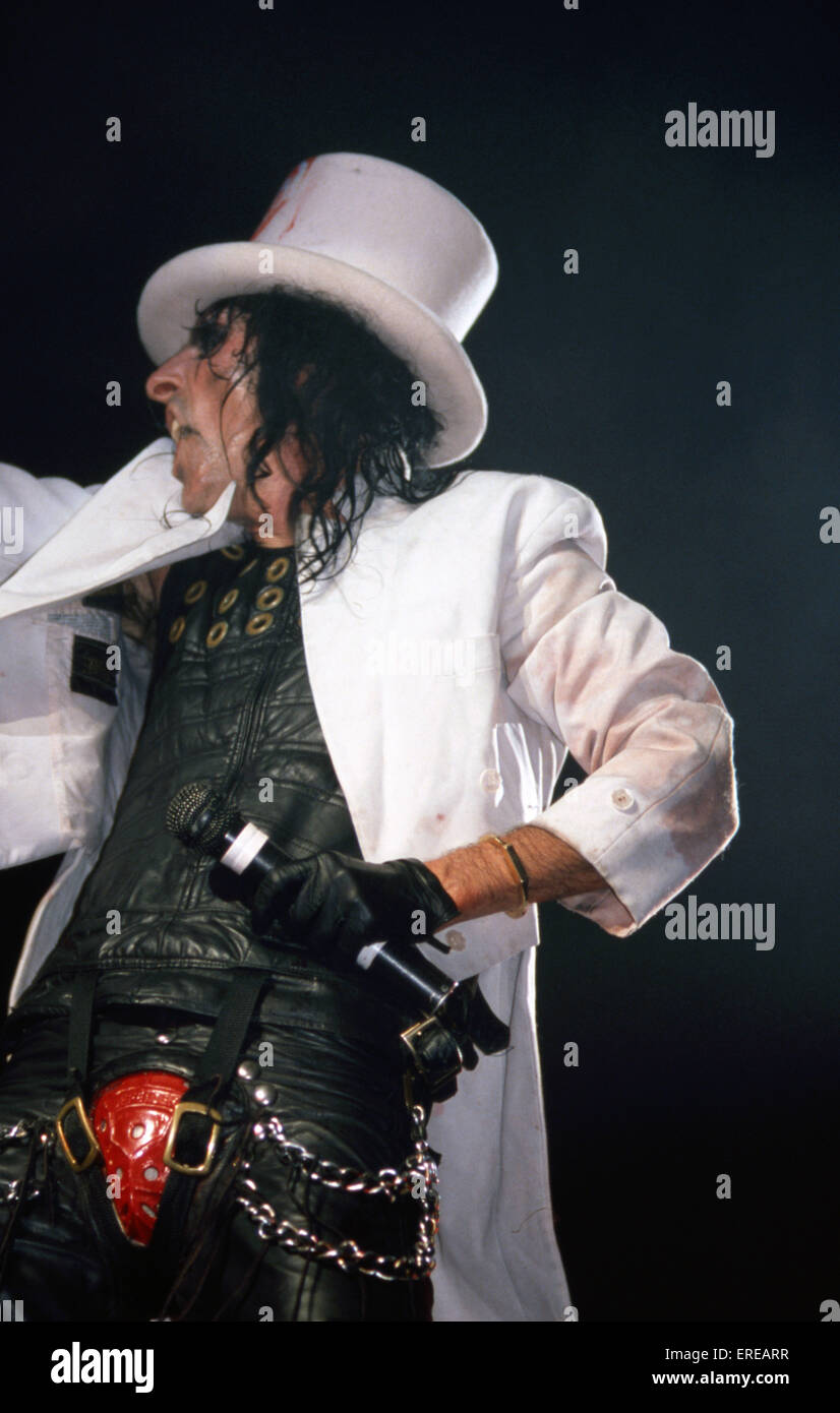 Alice Cooper Performing In Leathers A Codpiece A White Jacket And