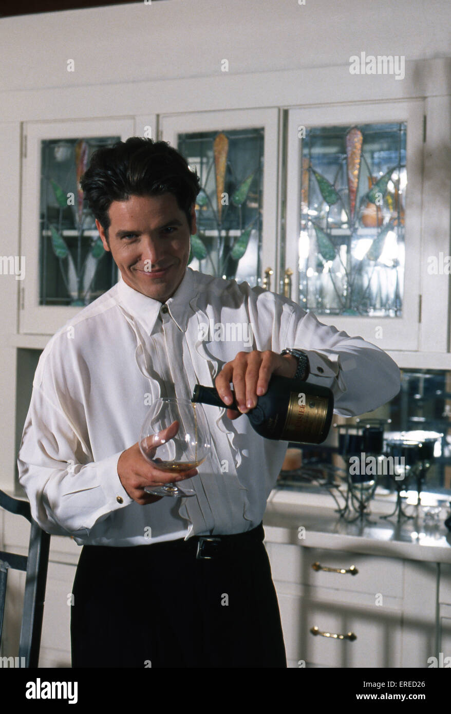 Michael Damian, portrait, pouring champagne in Los Angeles, USA. American actor, singer and producer, b April 26, - Stock Image
