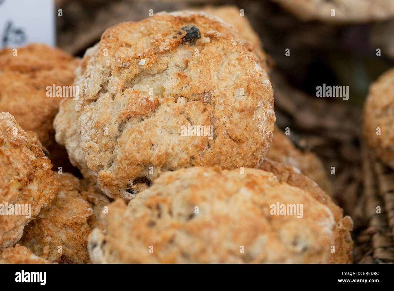 Close up Still life food image of home baked fruit scones in a basket - Stock Image