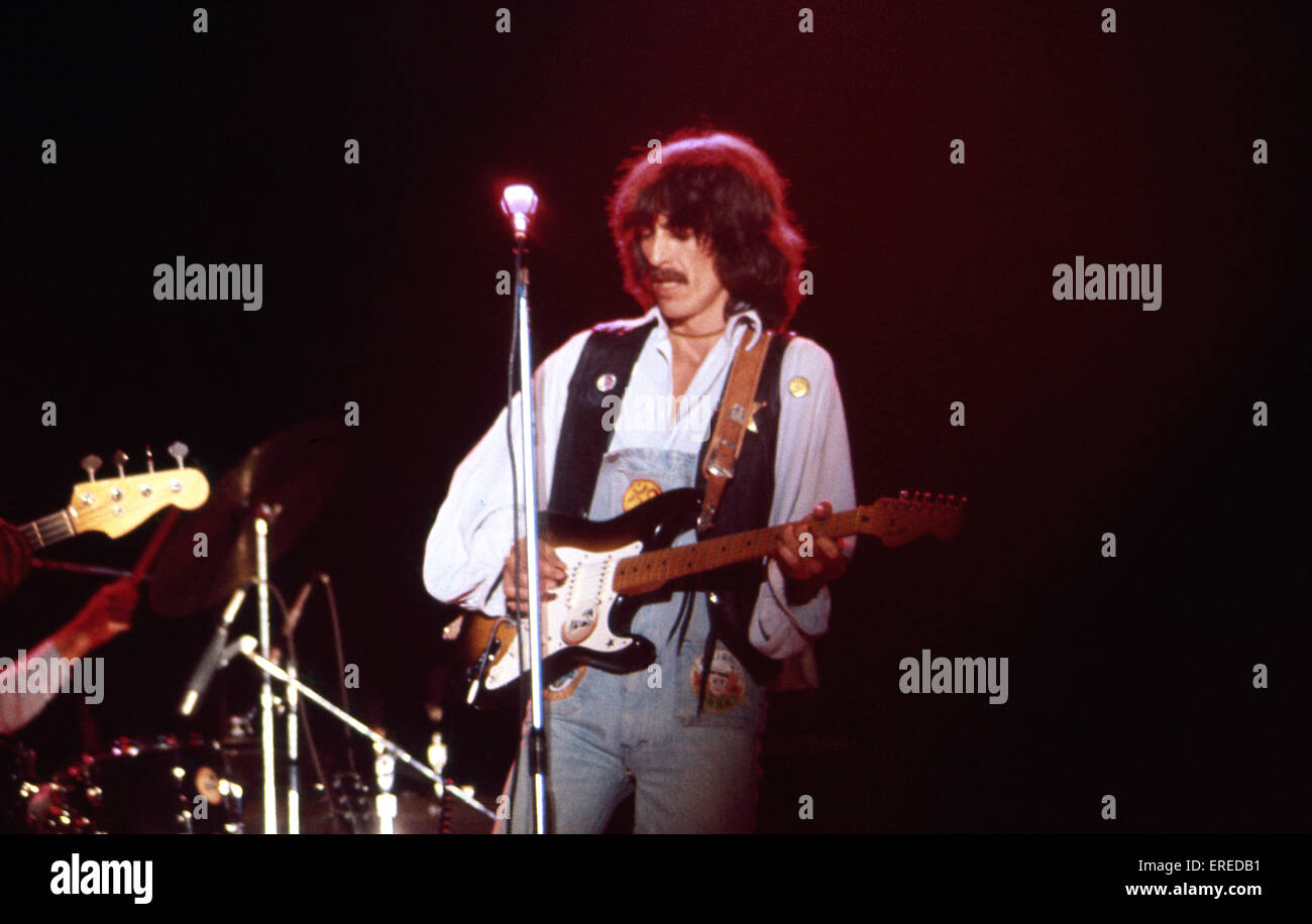 George Harrison, performing in Los Angeles, USA. English singer, songwriter, guitarist and former member of the - Stock Image