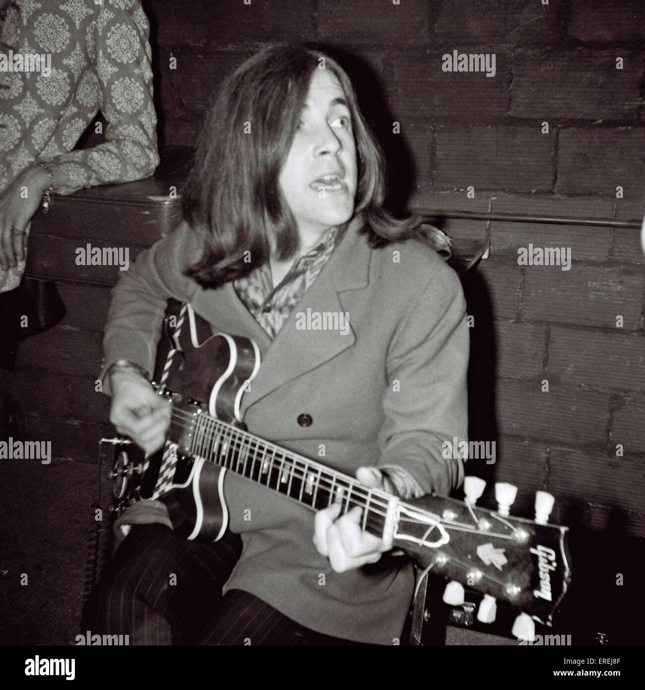 Singer Phil May, of English sixties band The Pretty Things, playing the guitar backstage at a concert at the Palais - Stock Image