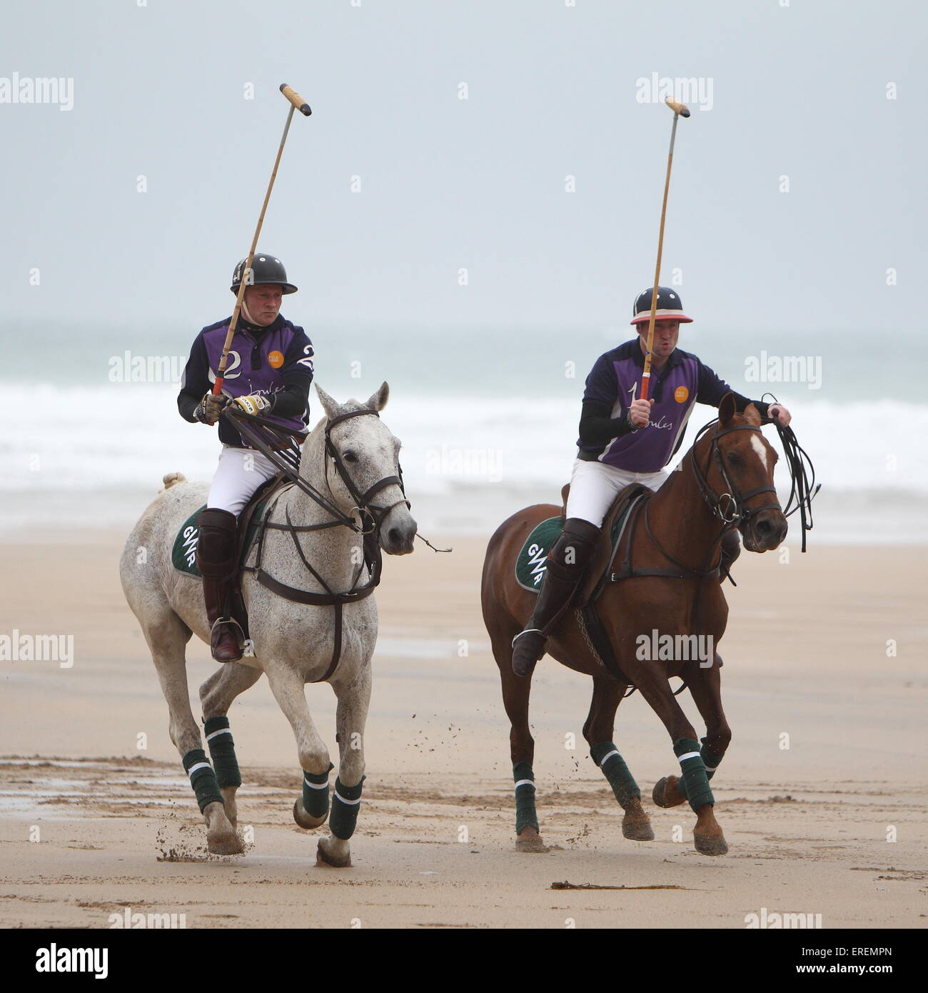 Watergate Bay, Newquay, Cornwall, UK. 2nd June, 2015. Professional Polo players Andy Burgess riding Tonka and Daniel - Stock Image