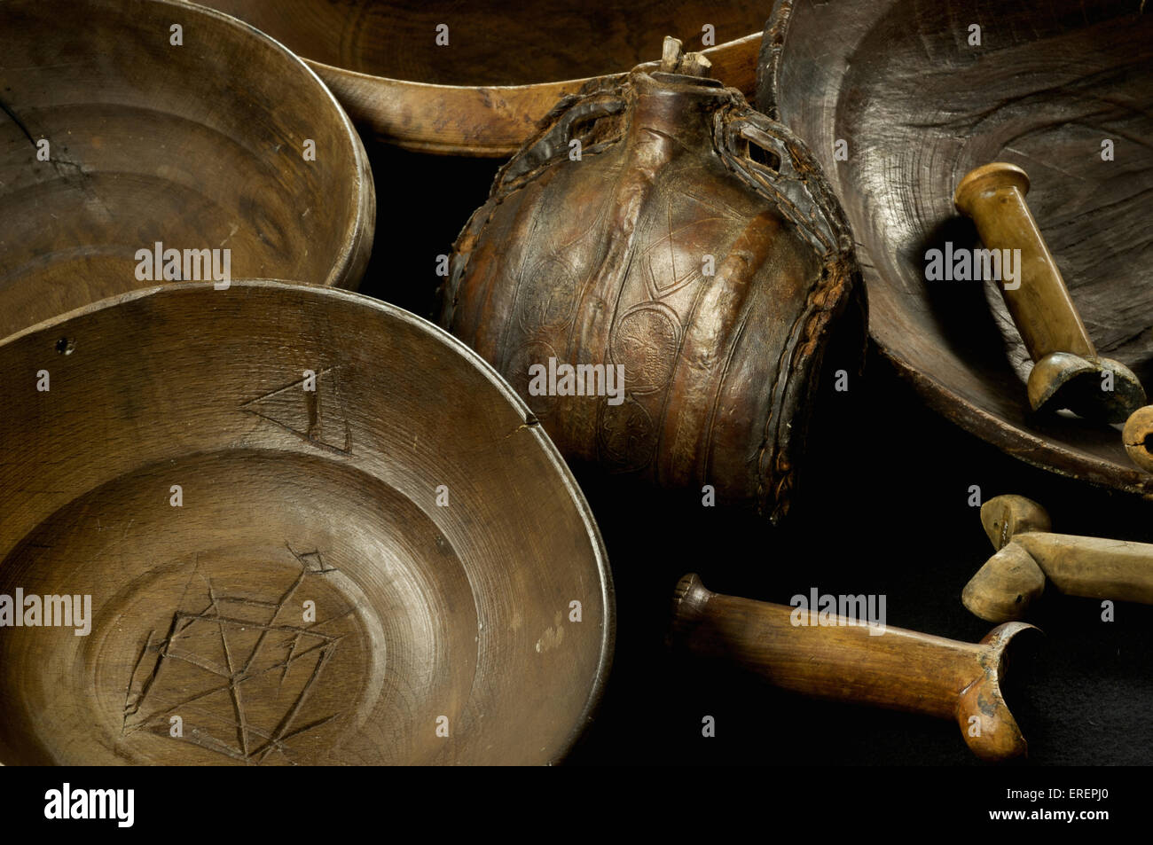 Wooden bowls, kidney dagger handles and a leather flagon recovered from the Mary Rose Stock Photo