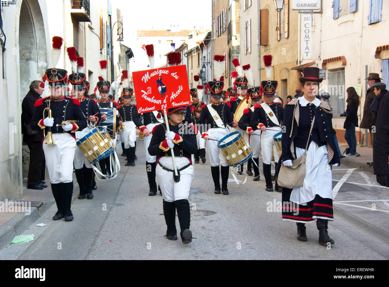 Drummers of the Musique du Tambour d'Arcole in Napoleonic light infantry uniform  marching in the village of Roquemaure, Stock Photo