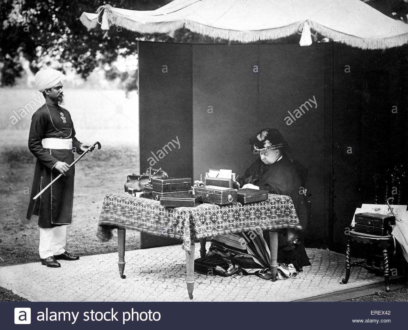 Queen Victoria attended to by Hafiz Abdul Karim, (the Munshi) 1893. Photograph taken by Hills & Saunders at - Stock Image