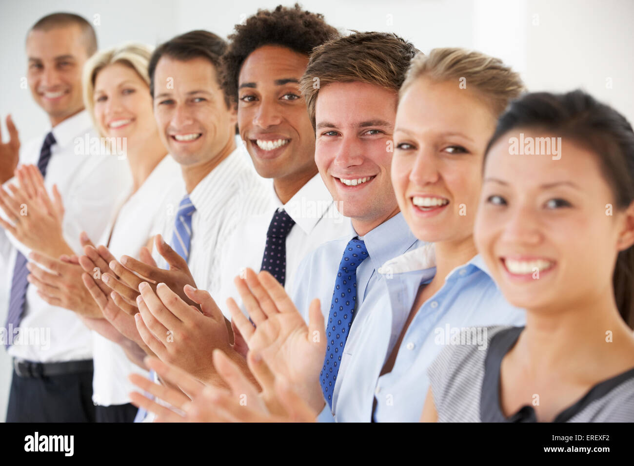 Line Of Happy And Positive Business People Applauding - Stock Image