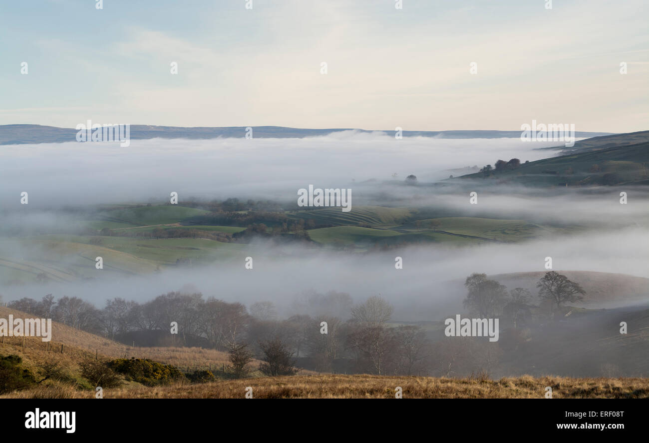Early morning mist in the Eden Valley, lifting as the sun rises. Kirkby Stephen, Cumbria, UK. - Stock Image