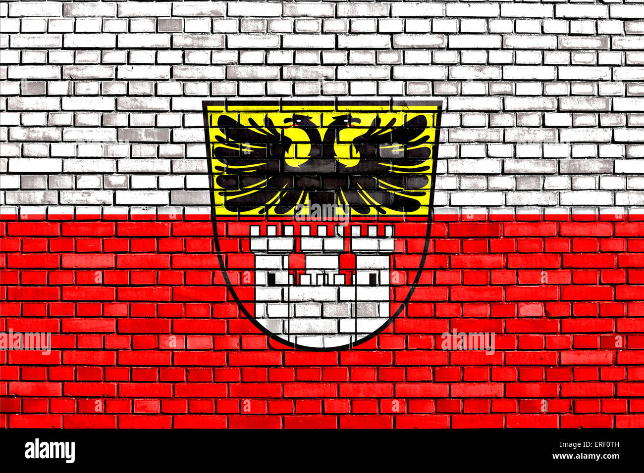 flag of Duisburg painted on brick wall - Stock Image