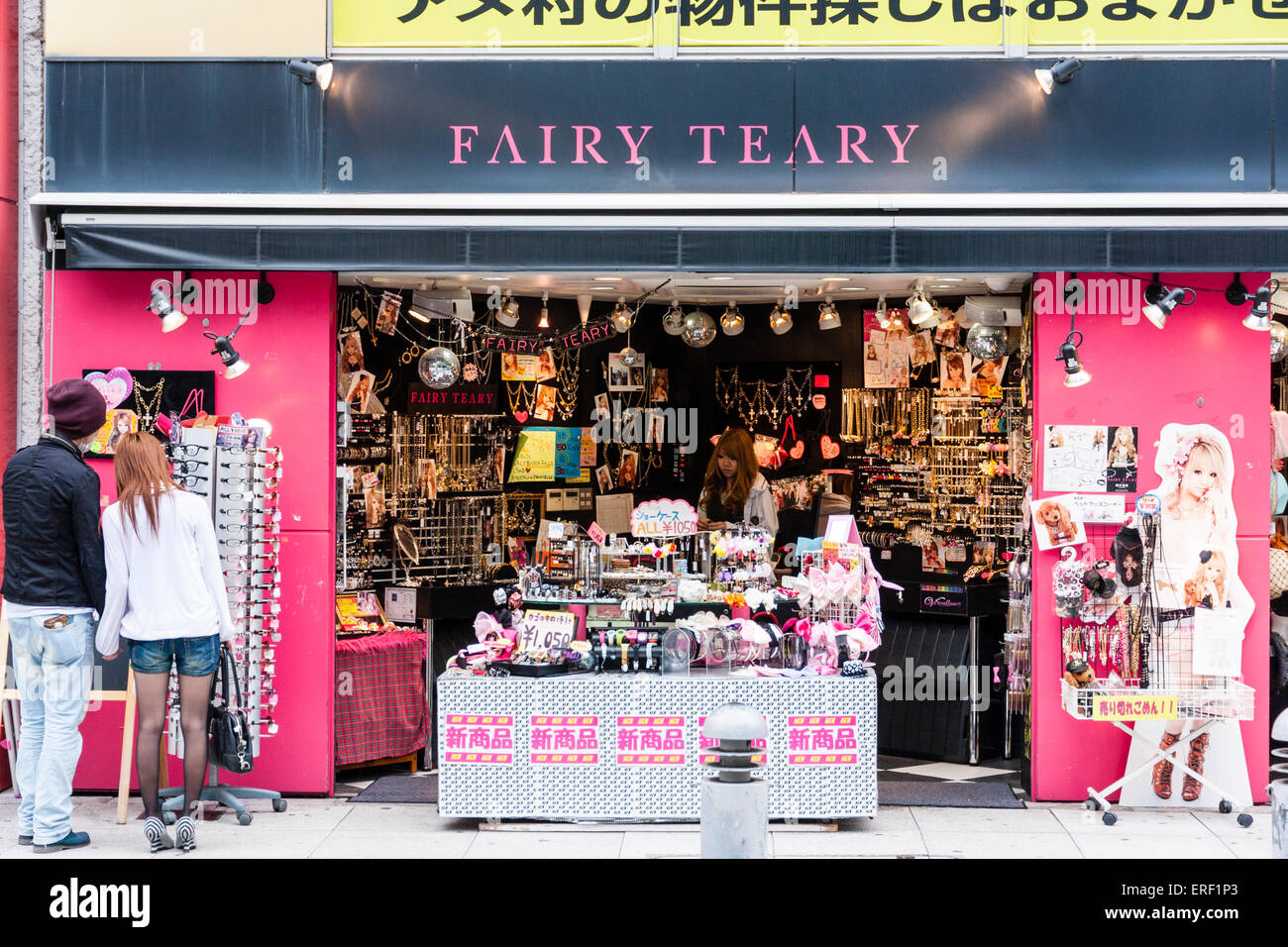 Japan, Osaka, Amerika-murai, 'Fairy Teary' boutique for accessories for women, young couple outside looking - Stock Image