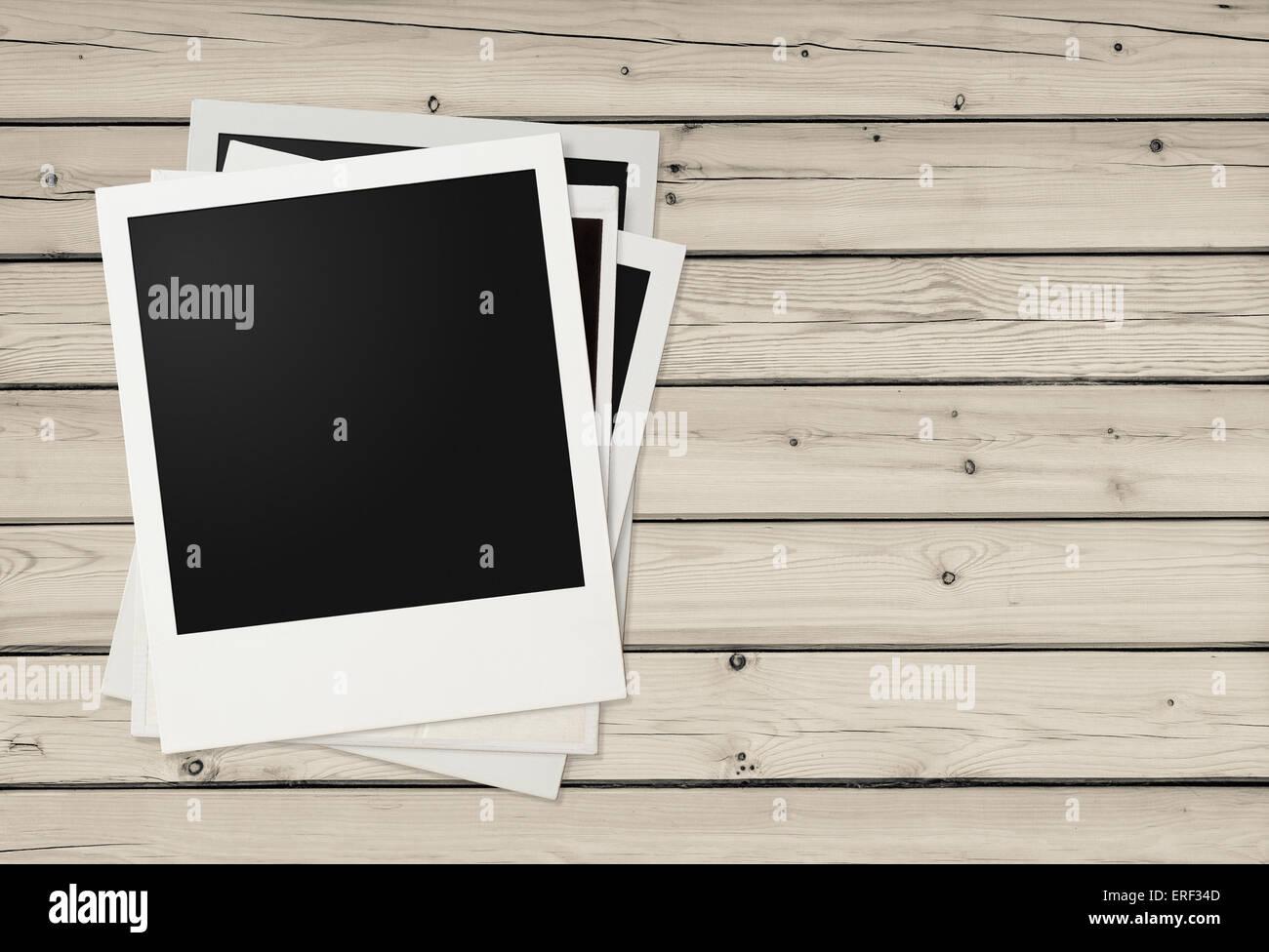 Polaroid photo frames on wooden background - Stock Image
