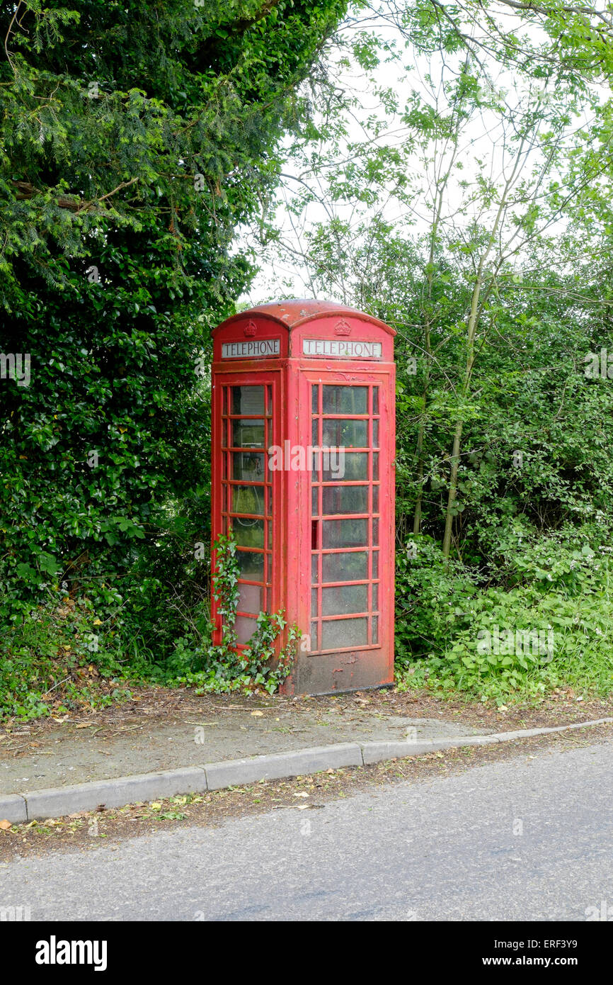 Neglected K6 red public telephone kiosk in rural location UK - Stock Image