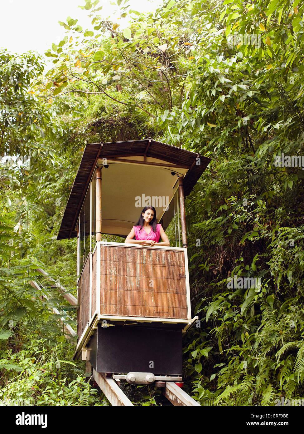 Young woman rides the funicular (or tram) at Ubud Hanging Gardens, Bali, Indonesia. - Stock Image