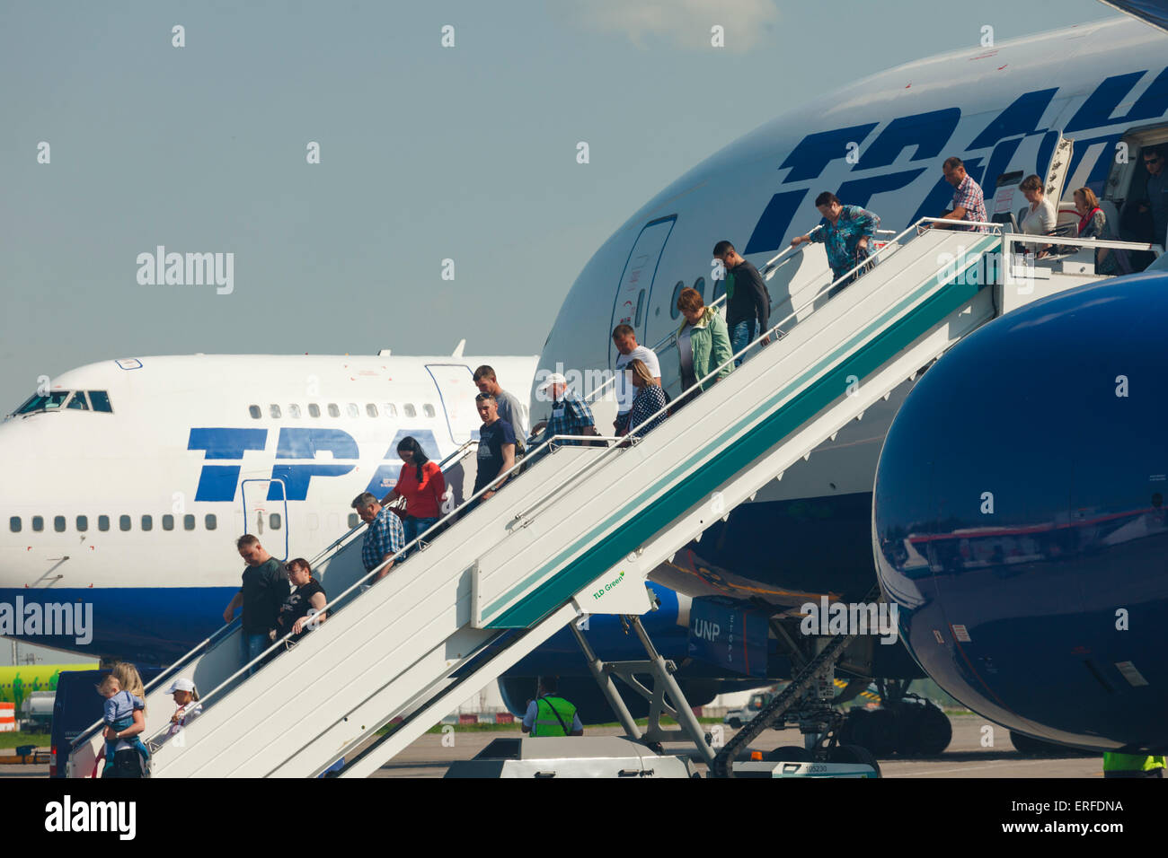 MOSCOW, RUSSIAN FEDERATION - MAY 26, 2015: Passengers leaving airplane. Oficial spotting in Domodedovo airport (DME) - Stock Image