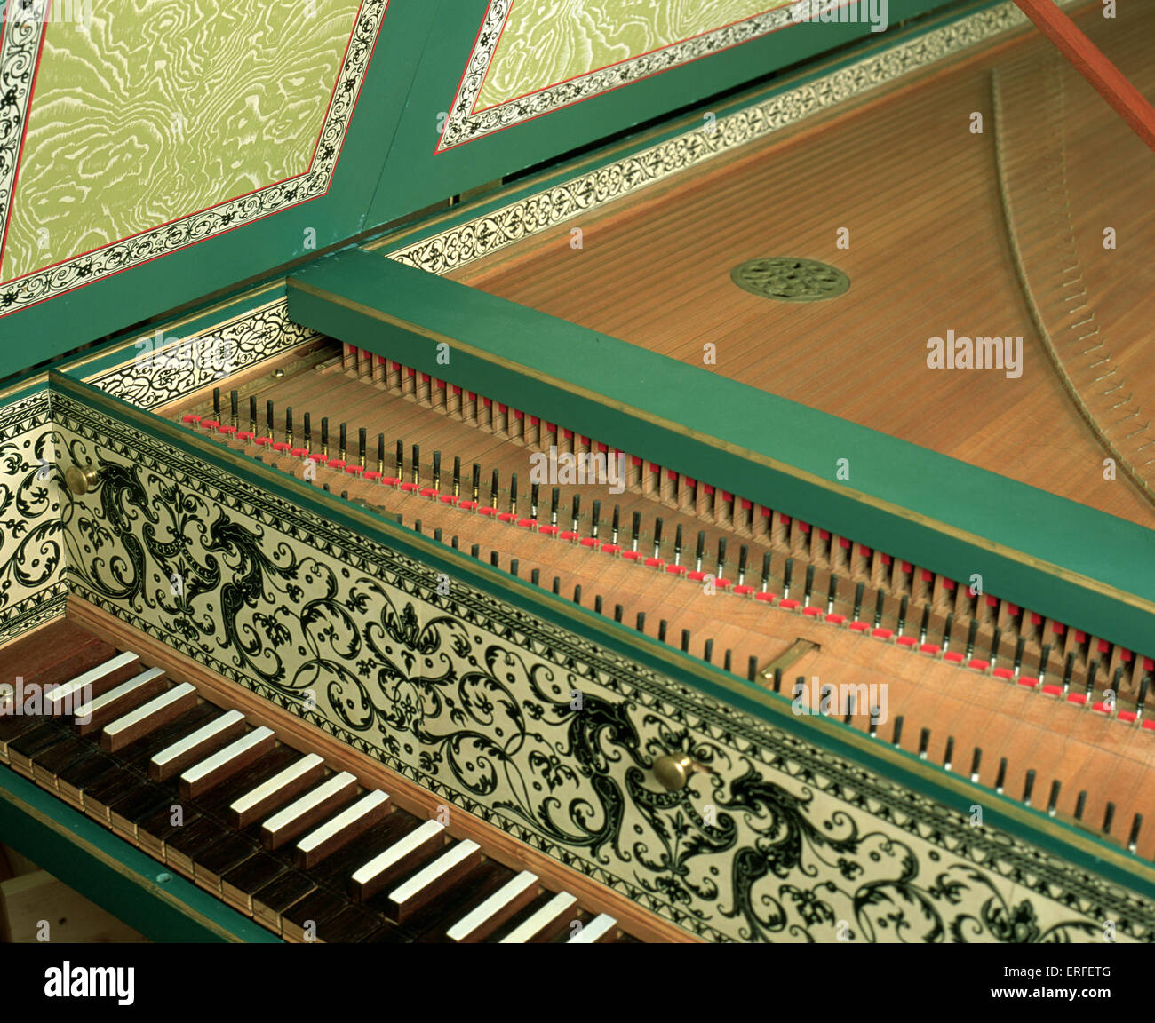 Harpsichord with open lid, showing strings, keyboard, sound