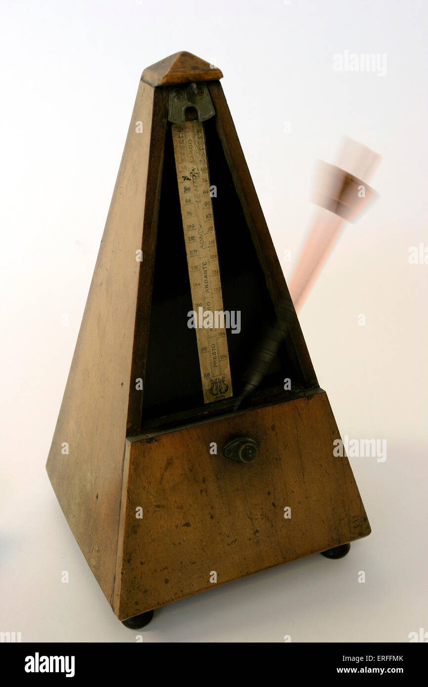 Wooden metronome - in motion beats time - Stock Image