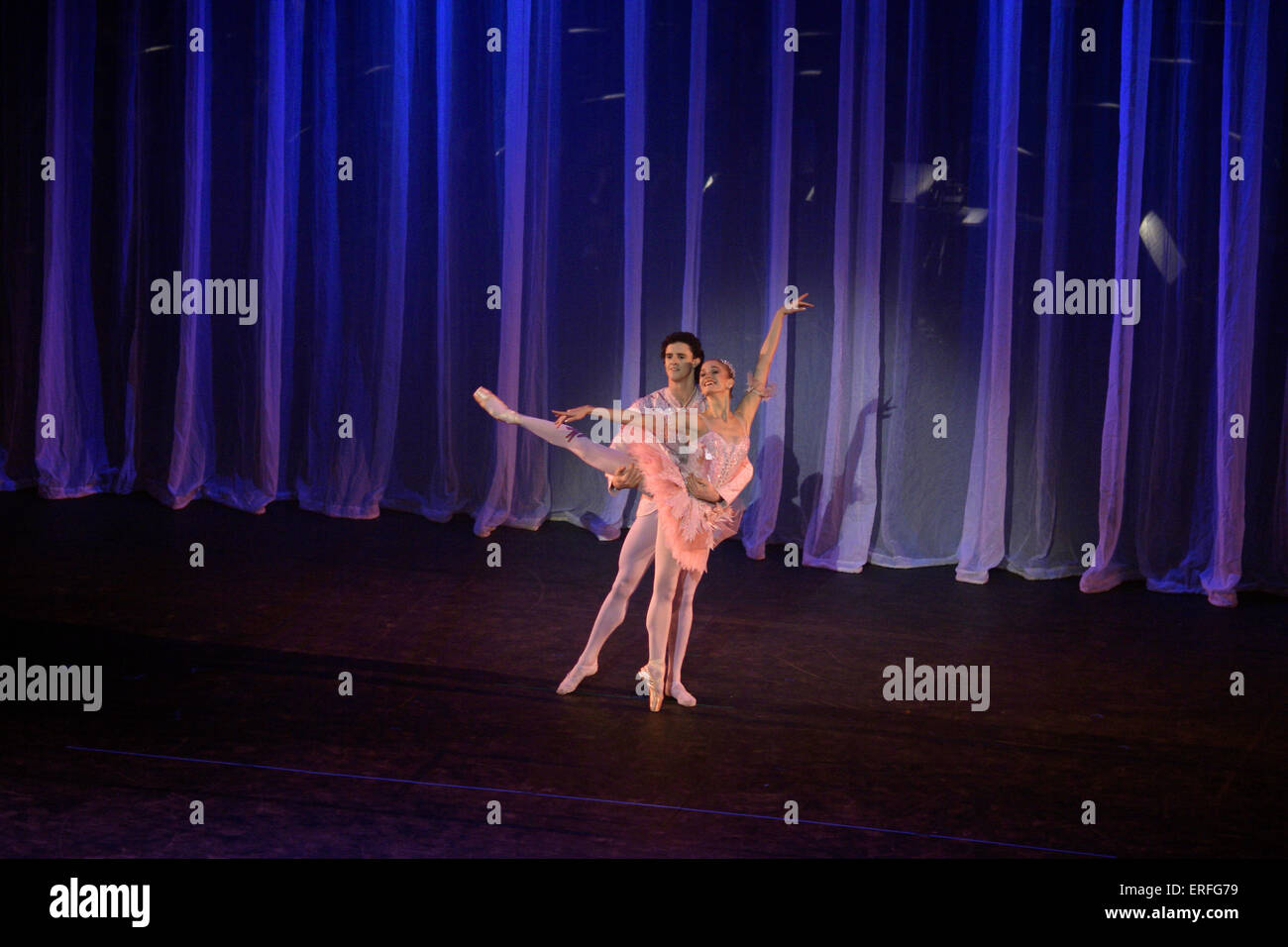 Ballet dancers dancing against backdrop of curtains. from Birmingham Royal Ballet - Wales Millennium Centre opening - Stock Image