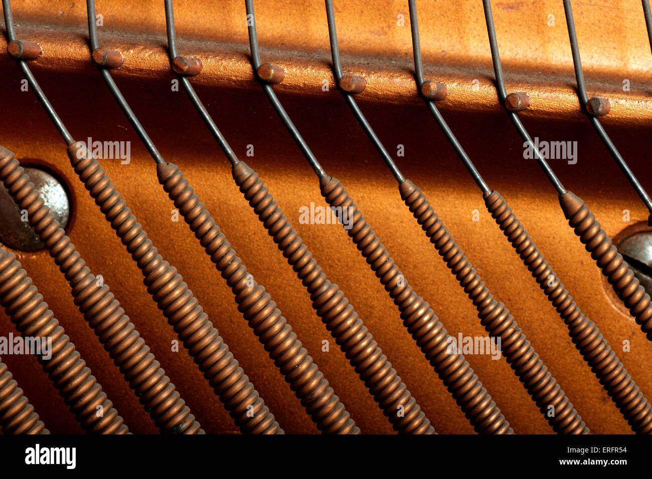 Bass strings from an upright piano - Close-up detail Stock Photo