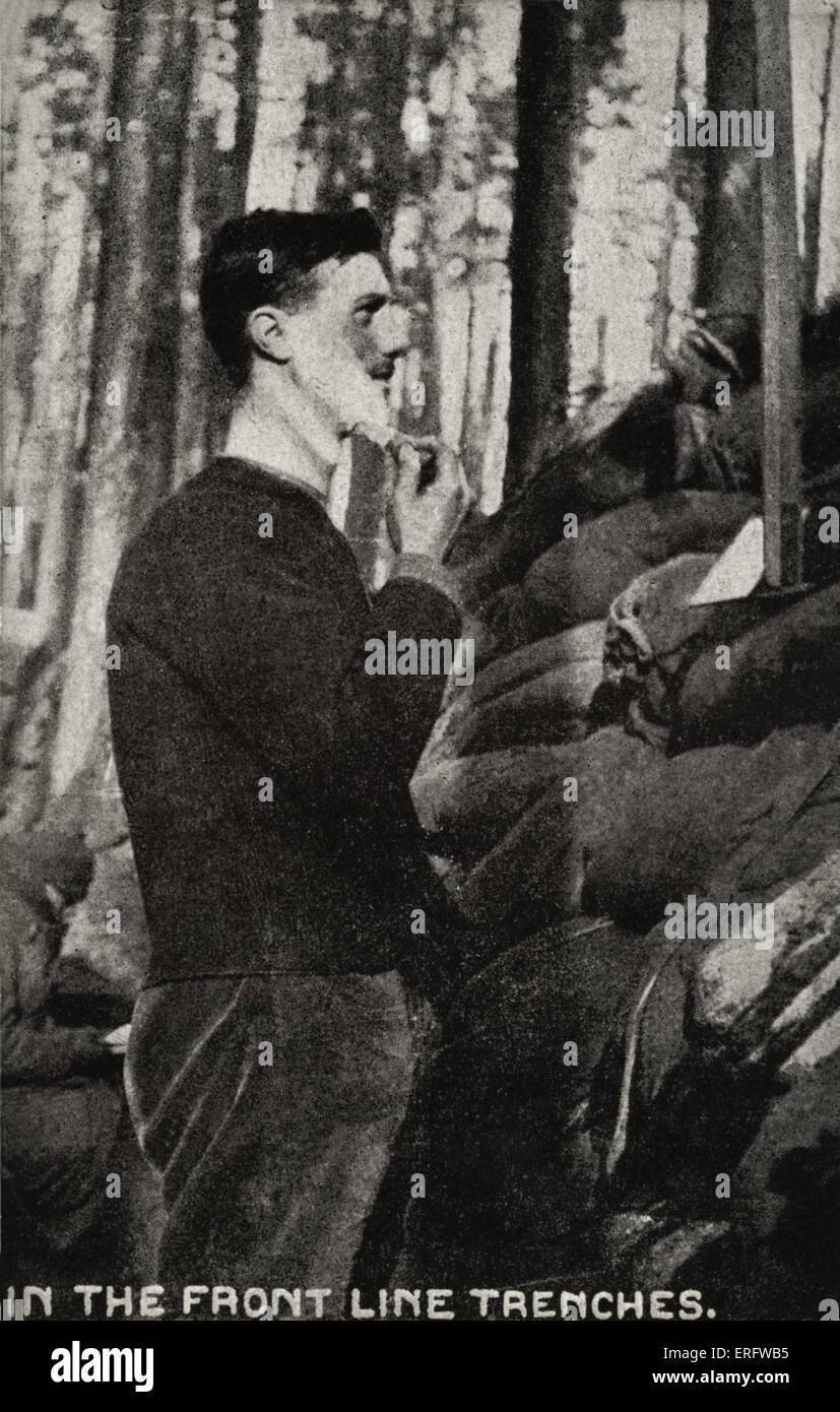 World War I 'In The Front Line Trenches'. Soldier shaving himself in the trenches. Photograph on card issued - Stock Image