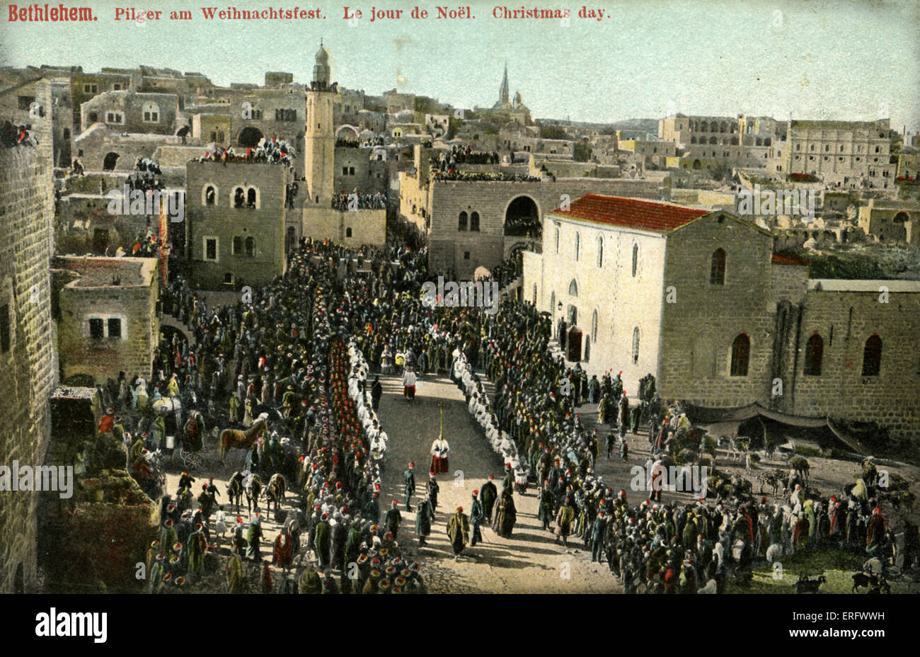 Christmas day in Bethlehem, late 1800s, early 1900s. Pilgrims watch procession to the Church of the Nativity. - Stock Image