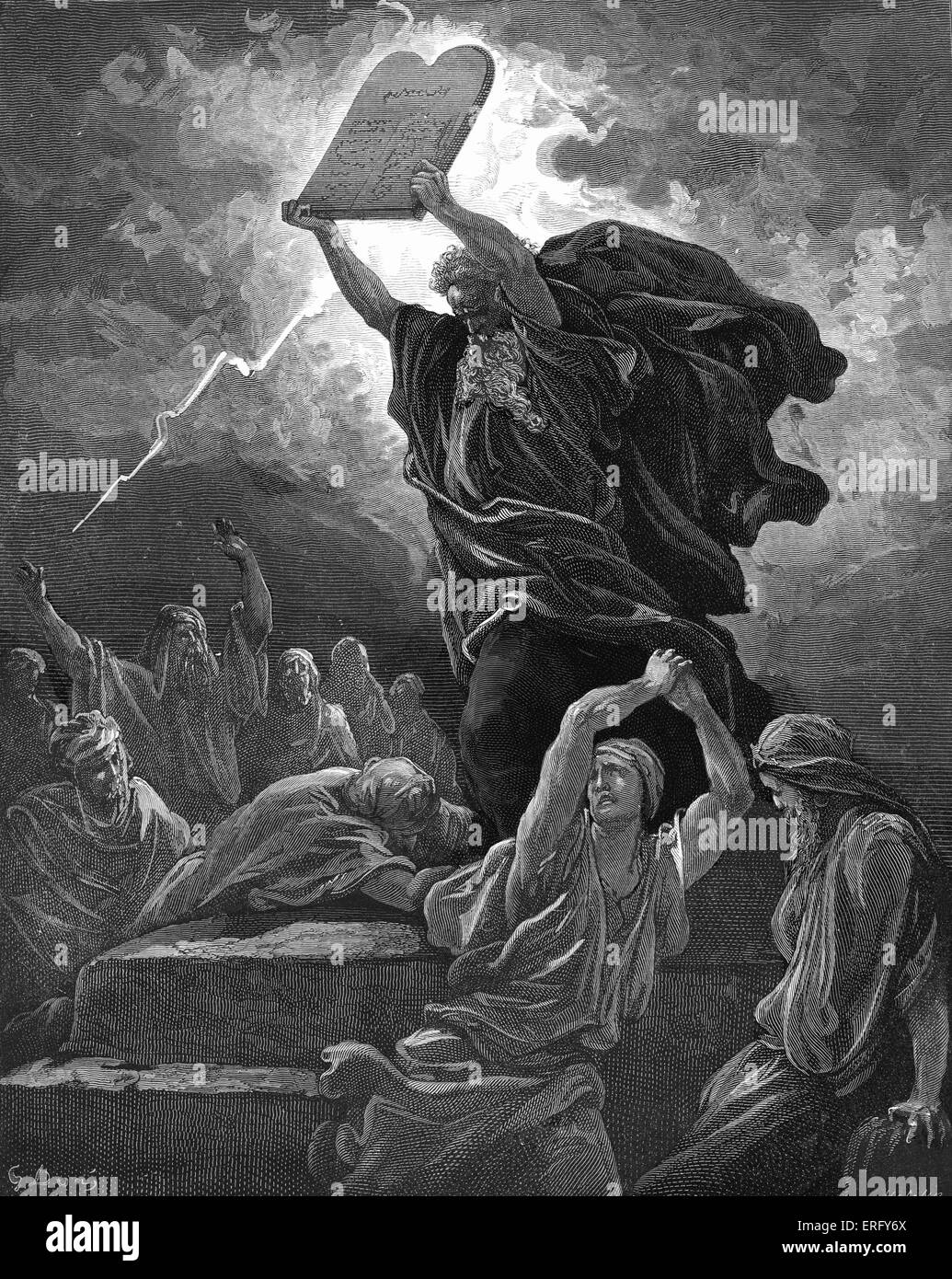 Moses breaks the tablets of the law after coming down from Mount Sinai and finding the children of Israel worshipping - Stock Image