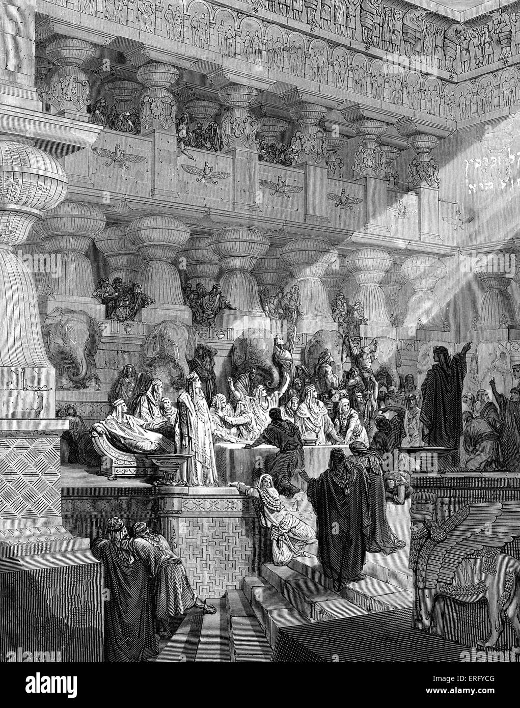 Daniel interprets the writing on the wall in the court of Babylon.  Engraving by Gustave Doré (1832 - 1883). - Stock Image