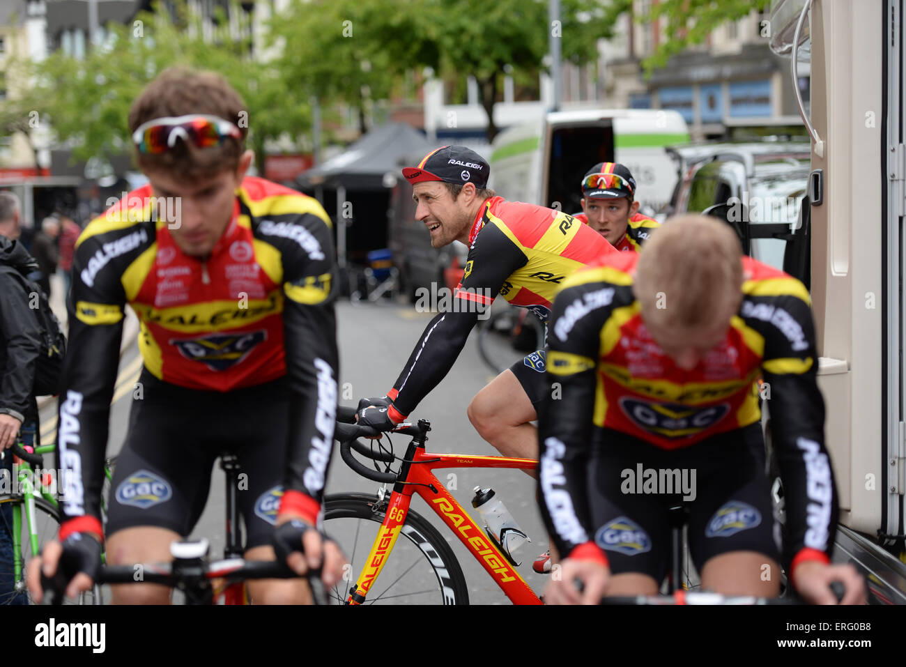 Riders from the Raleigh GAC team warm up before the Milk Race at Nottingham, United Kingdom on 24 May 2015. - Stock Image