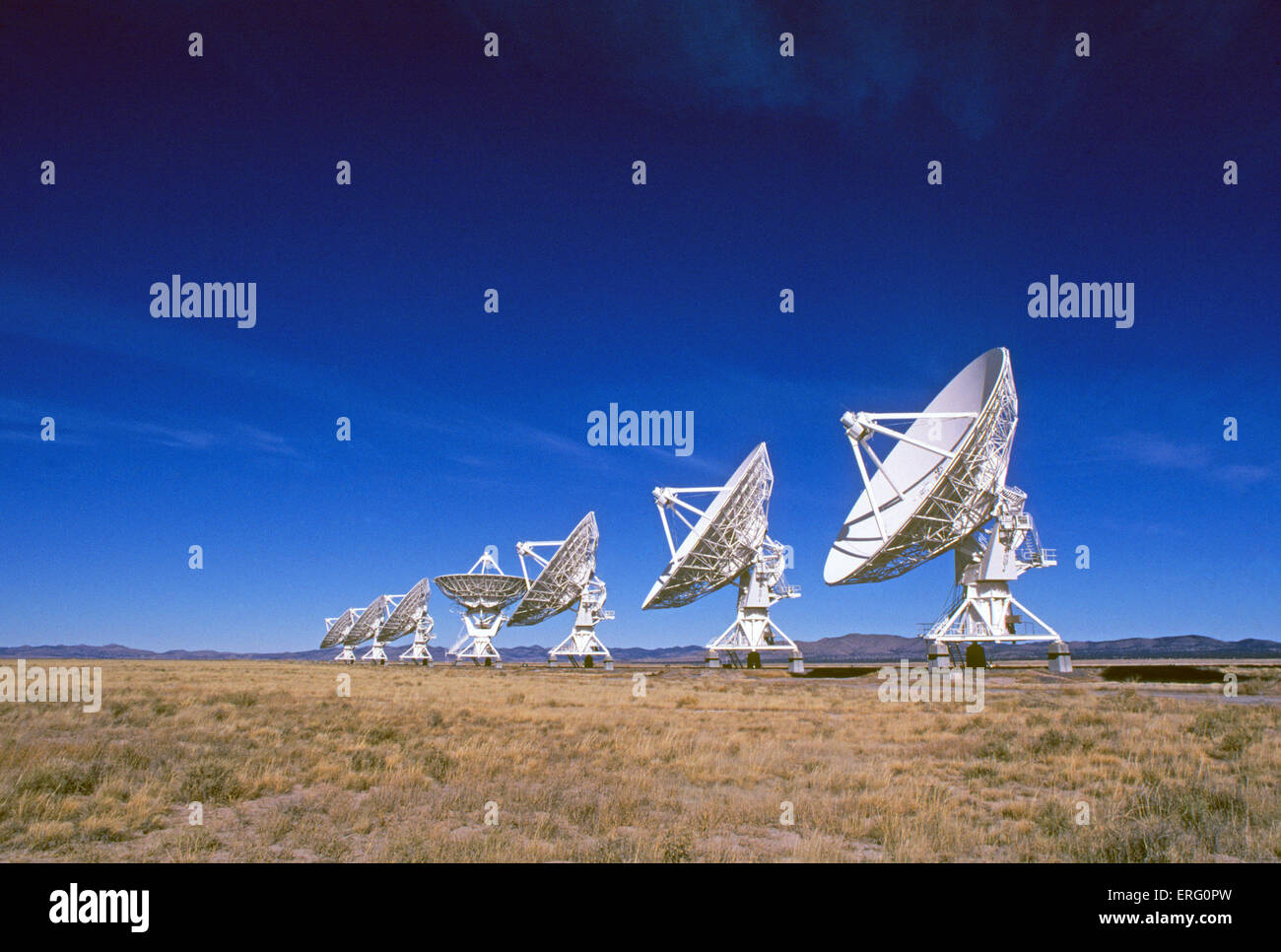 The giant radio telescopes of the Very Large Array, or VLA, on the Plains of San Agustin, between the towns of Magdalena - Stock Image