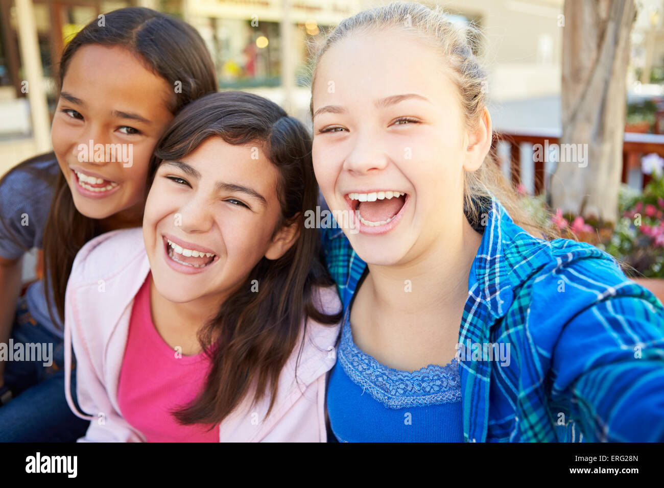 Group Of Girls Hanging Out In Mall Together - Stock Image