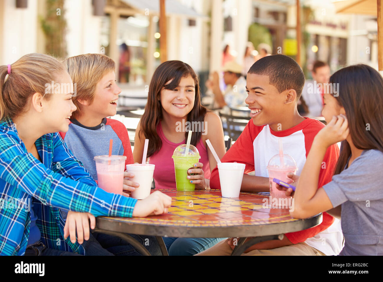 Group Of Children Hanging Out Together In CafŽ - Stock Image