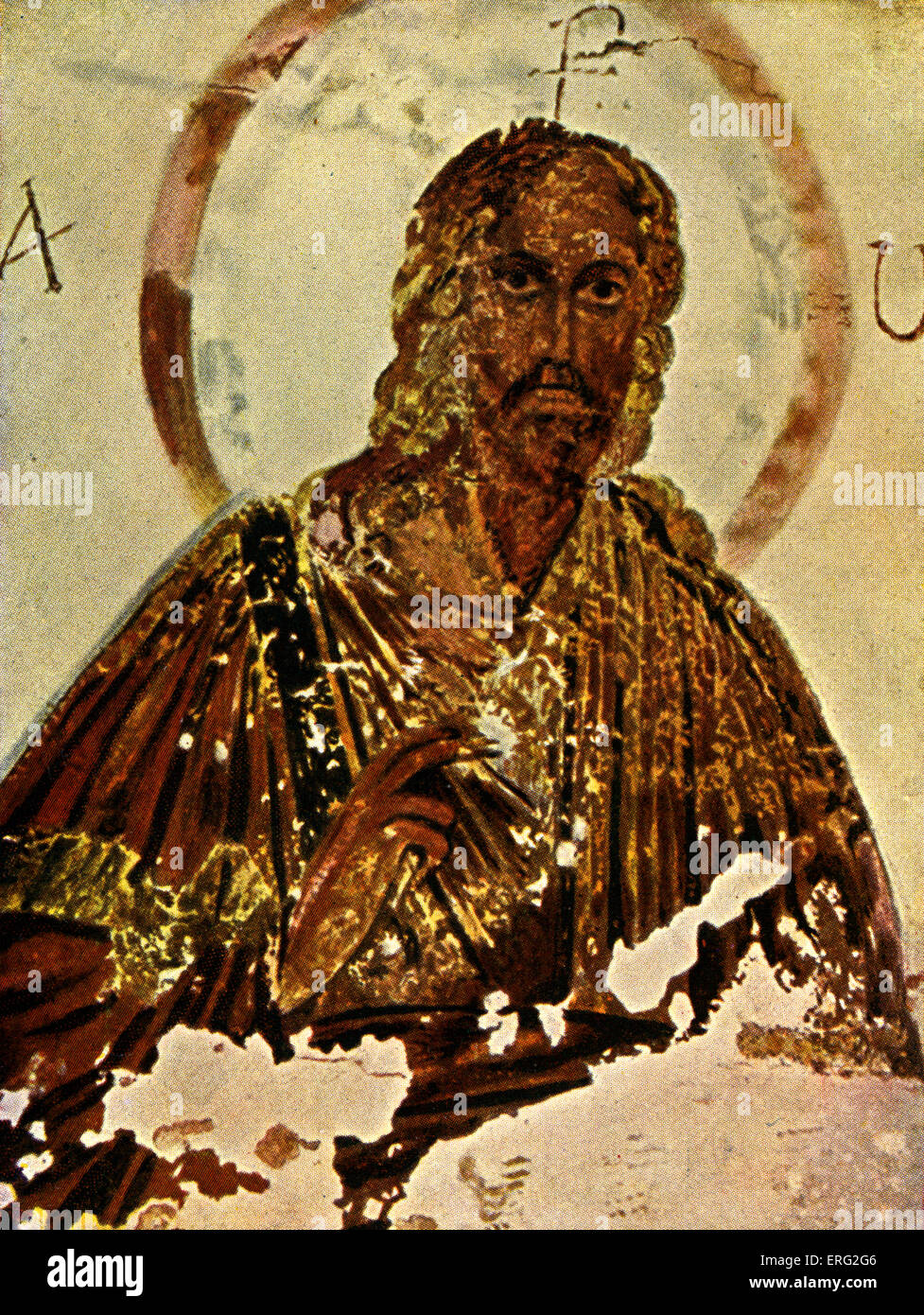 Fresco depicting Jesus with a halo. On either side of him the first and last vowels of the Latin alphabet and above - Stock Image