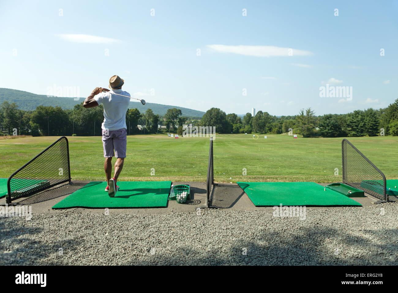 Golf at the Driving Range - Stock Image