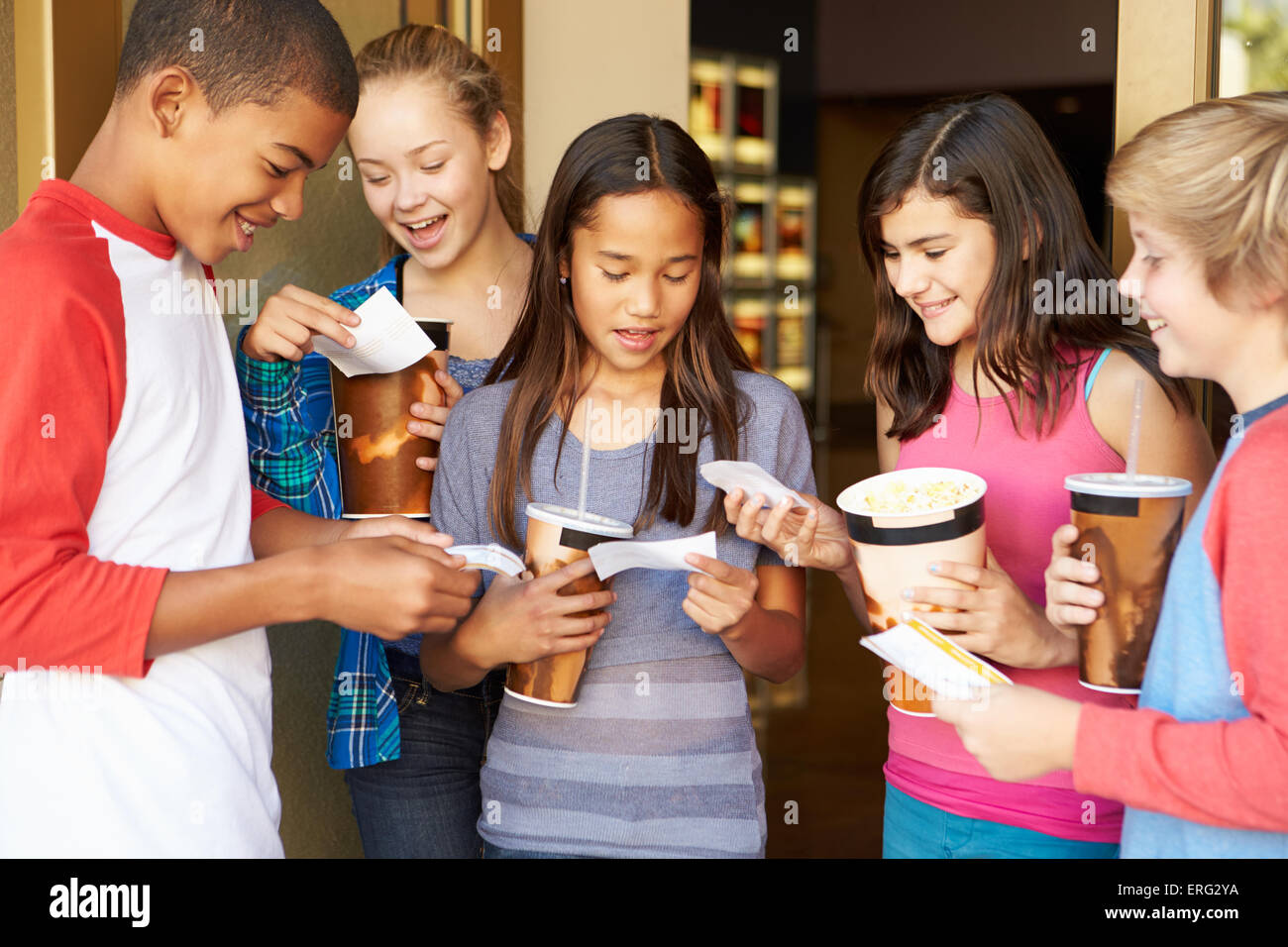 Group Of Children Standing Outside Cinema Together - Stock Image