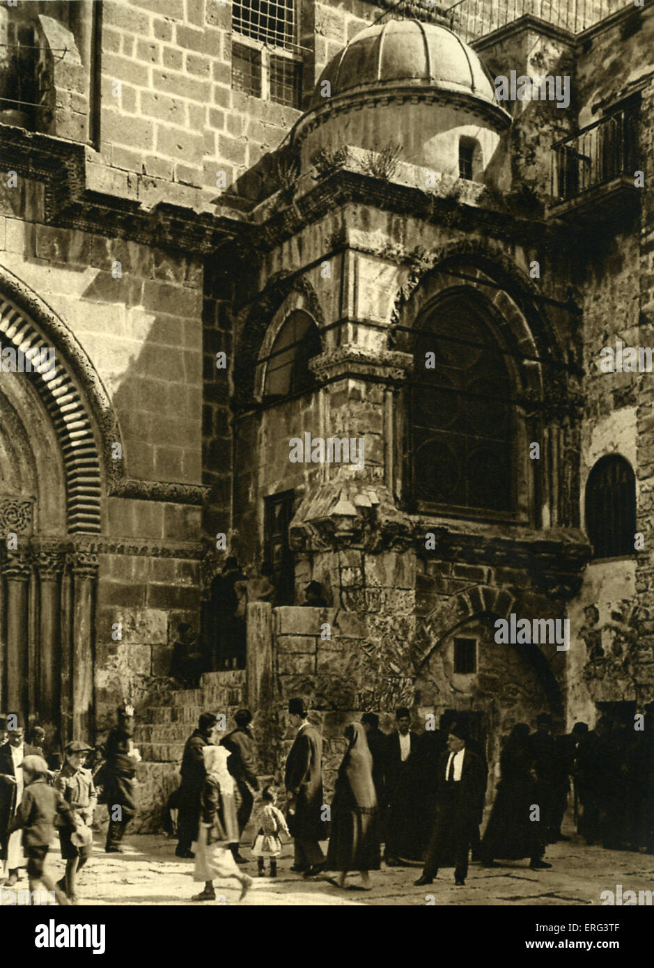 Jerusalem, exterior of the Church of the Holy Sepulchre, Chapel of the Agony of the Virgin.  Moslems and Jews pass - Stock Image