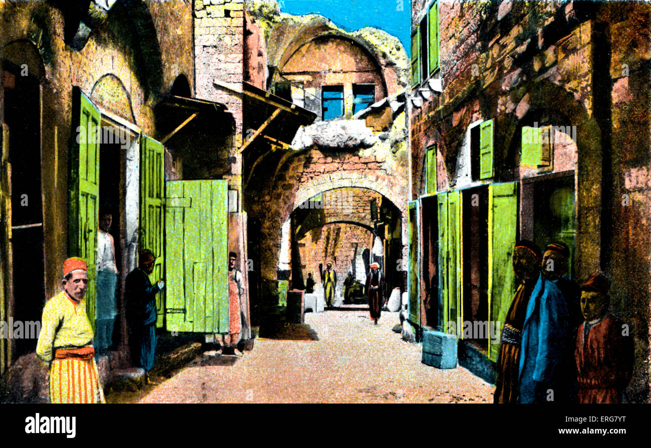Jaffa - Arab quarter. Late 1800s, early 1900s. Shopowners standing outside their shops in narrow streets. Published - Stock Image