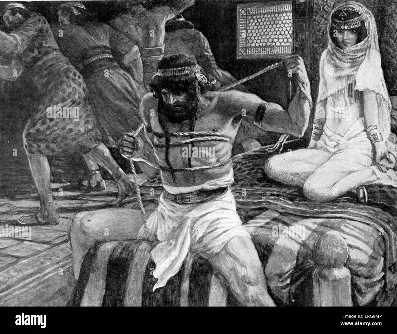 Samson breaks his cords by J James Tissot. Illustration to the Book of Judges 16.9 : 'Now there were men lying - Stock Image