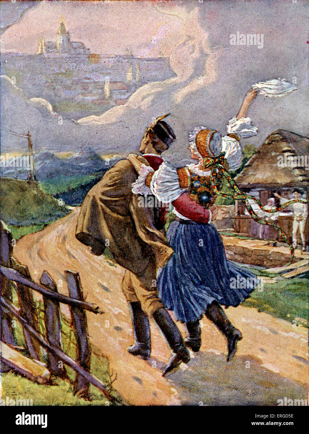 Young Czech couple in national dress, c.1920. Dancing down village road to Prague, in the distance. Stock Photo