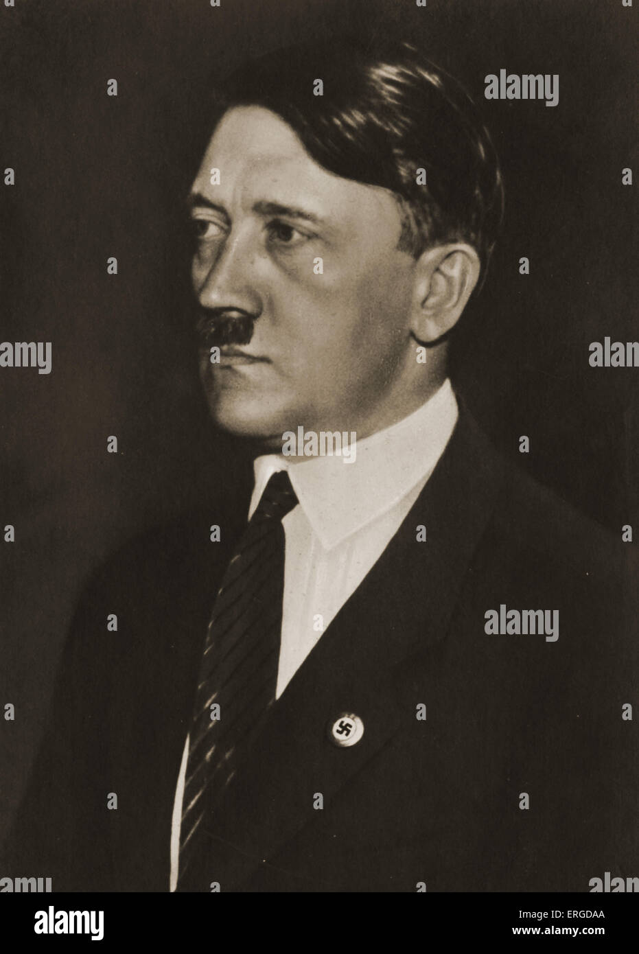 Adolf Hitler wearing tie (unusual). With Nazi badge on lapel. Founder and leader of German Nazi Party, 20 April - Stock Image