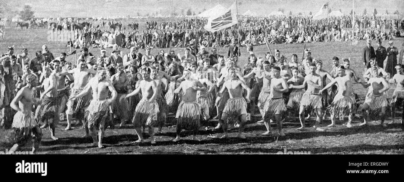 Maori warriors dancing the haka before the Duke of Cornwall (future George V) at Roturua, New Zealand. During Empire - Stock Image