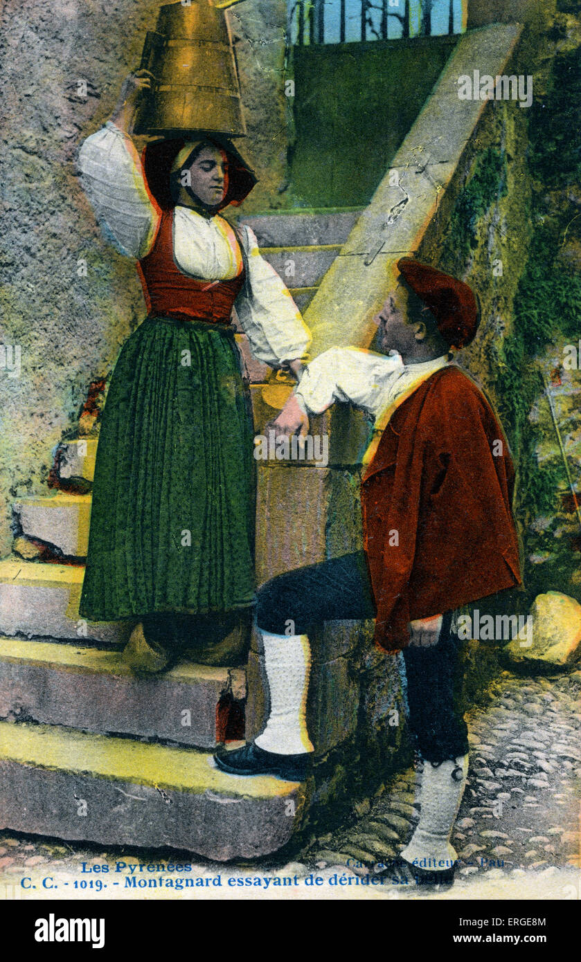 Pyrenees - man in traditional moutain dress trying to cheer up his companion   ('Montagnard essayant de dérider Stock Photo