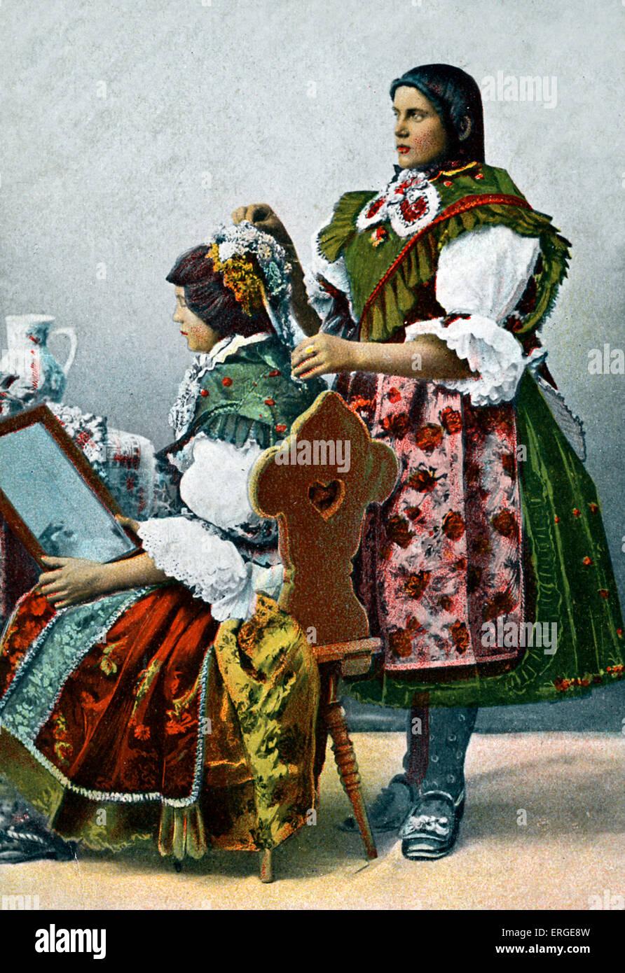 Folk costumes in Barany, Hungary. Caption: 'Romanyai viselet' ('Romany wear'). - Stock Image