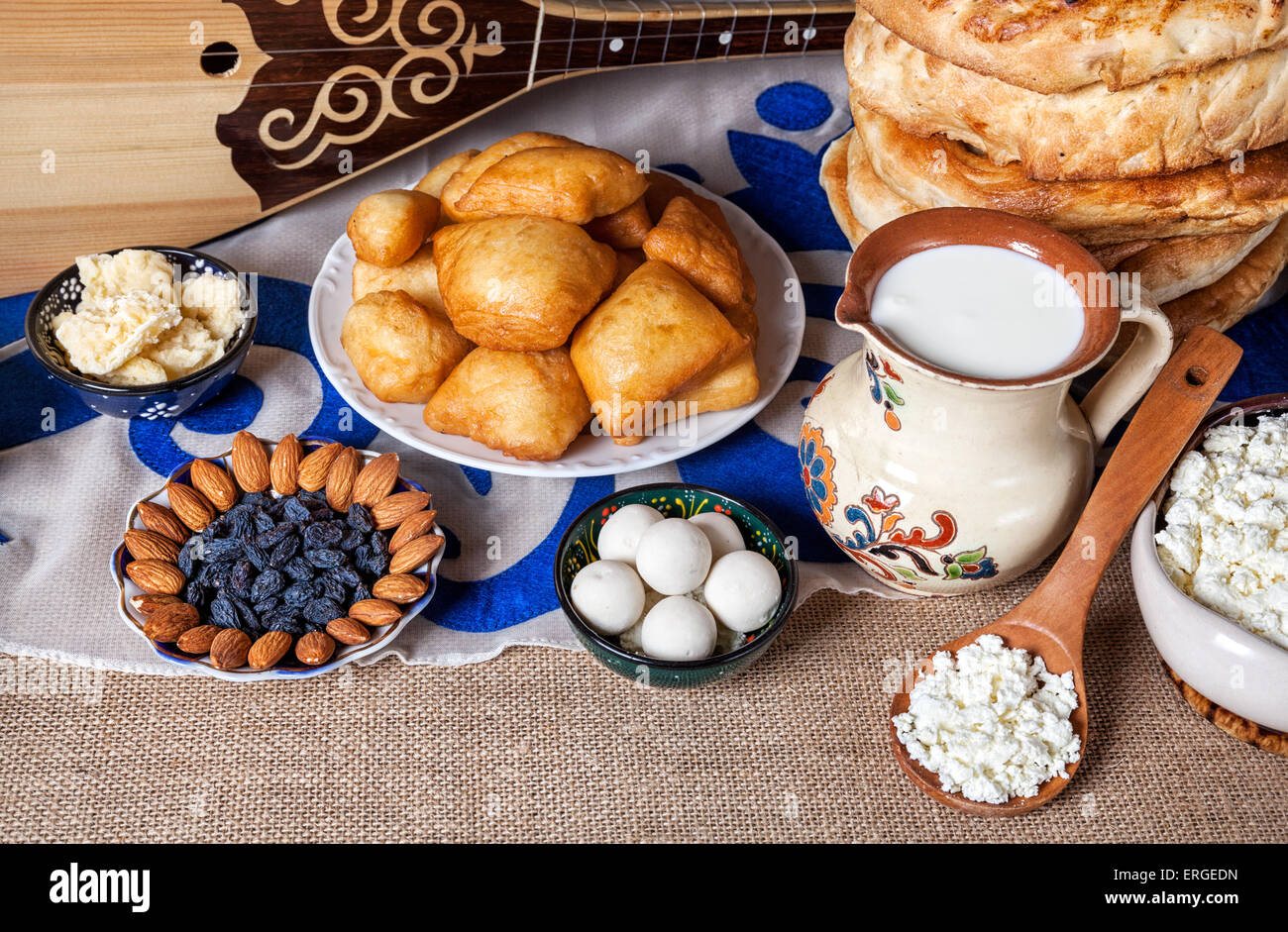 Asian dishes and Dombra Kazakh instrument on the table - Stock Image