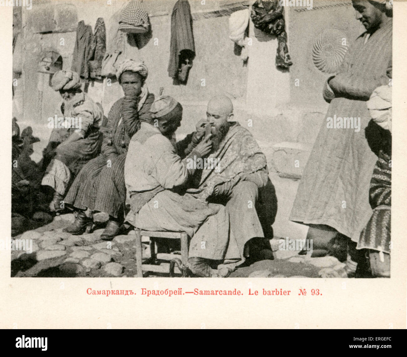 Barber plying his trade  in streets of Samarkand, c. 1900. Modern day Uzbekistan, until 1924 part of Russian Empire. - Stock Image