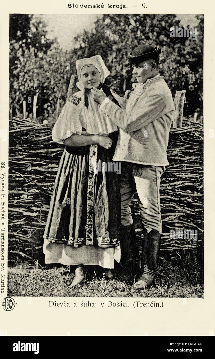 Slovak folk costumes: Girl and boy in Bošáca, Trenčín. Modern day Slovakia. Pre - 1902. - Stock Image