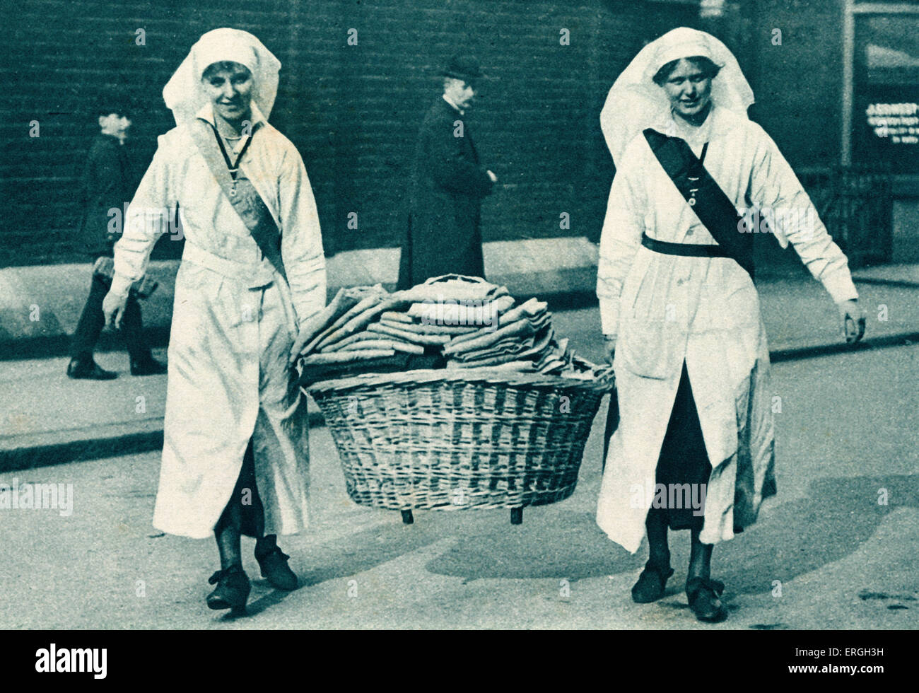 Queen Mary 's Needlework Guild during World War 1. Donations being carried in to the headquarters in Queen Anne - Stock Image