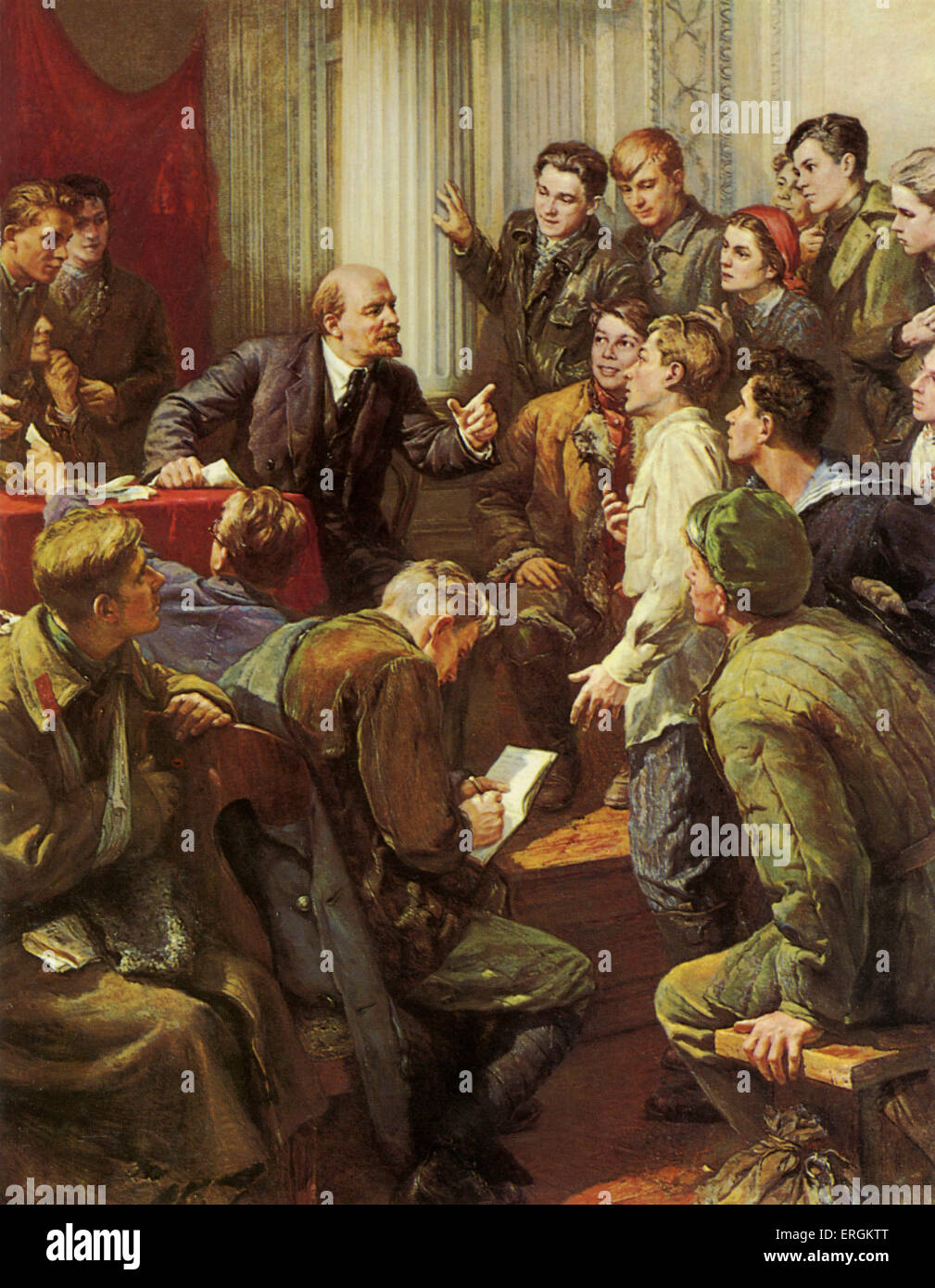 Lenin (1870-1924) surrounded by soviet youth. Here lenin holds a talk on his complete works to representatives of - Stock Image