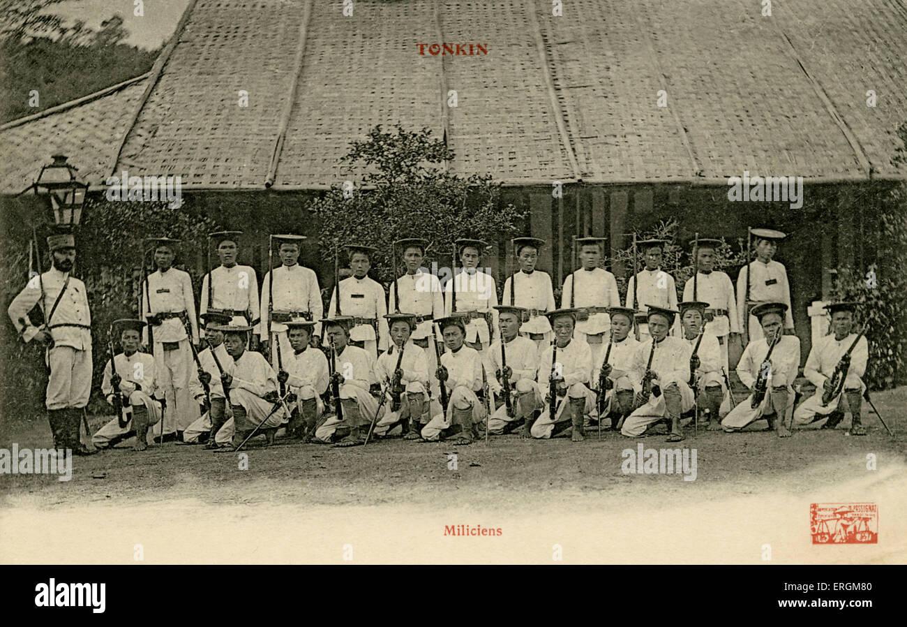 Vietnamese militia in Tonkin, north Vietnam.  Postcard used in 1908. - Stock Image