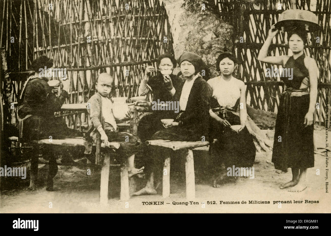 Wives of the Vietnamese militia Tonkin, north Vietnam. Postcard used in 1904. - Stock Image