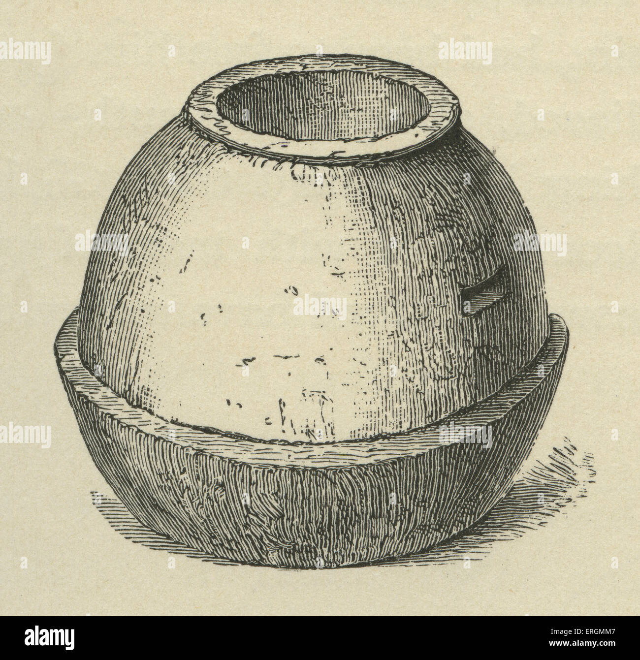 A primitive stone quern, used in the grinding of cereals and corn into flower. After an illustration from the archaeological - Stock Image