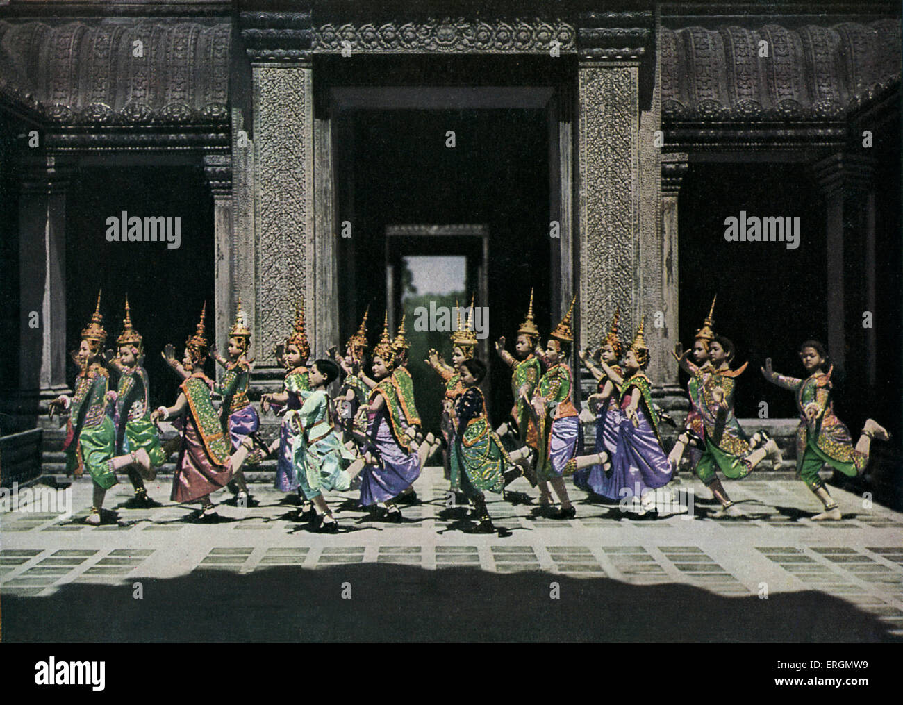 Cambodian folk dancers  in the Angkor Temple, c. 1931. - Stock Image
