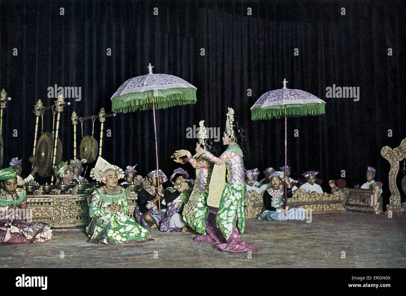 Balinese folk dancers performing in the Theatre of the Dutch Indies c. 1931. - Stock Image